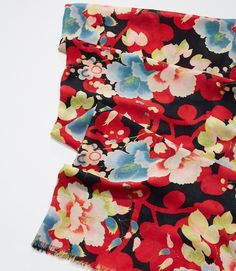 $34.50 Bursting with tropical florals, this soft scarf will tie your look together