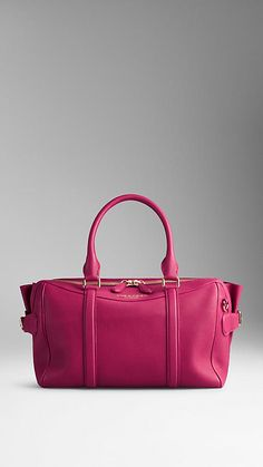 The Burberry Bee Bag in Grainy Leather in Tulip Pink.  The bag features a double-layered construction with concealed wing pockets lined in soft suede.  Discover women's bag at Burbrerry.com