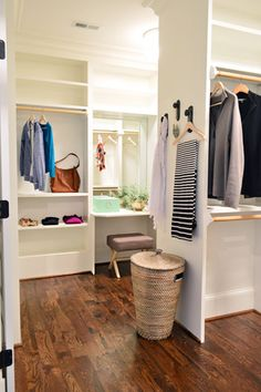 dual sided master bedroom closet. a really big master closet, but I do like the his/hers side with the vanity area.