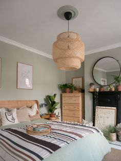 A cohesive bedroom design can be achieved by choosing key design elements. In this project, we chose a soft green colour palette, with organic woven materials (rattan, wicker), untreated wood a house plants Boho Bedroom Diy, Cute Bedroom Decor, Bedroom Green, Wood Bedroom, Bedroom Colors, Bedroom Inspo, Master Bedroom, Look Boho, Aesthetic Bedroom