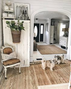Planked flooring and shabby white furniture