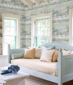 With a look that can transition from beachy chic to weathered and rustic, this distressed wallpaper invites simplified beauty to walls with a wood panel design in a mirage of coastal inspired hues.