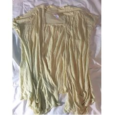 Free People Cardigan Soft yellow short sleeved cardigan with pockets in the front. Really cute I just never wore it. No flaws. Free People Tops Tees - Short Sleeve