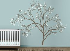 wall behind crib. customized w/ light grey trunk & pale pink &/or blue blossoms.