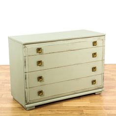 "This ""Mengel"" mid century modern dresser is featured in a solid wood with a distressed sage green paint finish. This shabby chic short dresser has 4 drawers, square brass handles and beveled trim. Perfect as a buffet credenza!  #shabbychic #dressers #armoireorwardrobe #sandiegovintage #vintagefurniture"