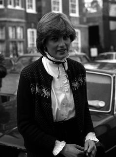 November Lady Diana Spencer leaving Coleherne Court, wearing a burgundy reindeer cardigan. Lady Diana Spencer, Spencer Family, Princess Diana Fashion, Princes Diana, Isabel Ii, Royal Engagement, Diane, Princess Of Wales, Prince Charles
