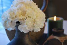 White flowers in a dark vase --- Sigh!