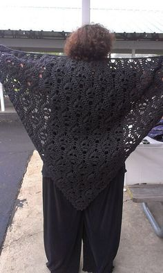 "Seeing so many skull shawl patterns lately that are an open kind of lace work made me wonder if there wasn't some other way to present this popular motif. Then it occurred to me to use a tessellating setting, and after a bit of trial and error the shawl with the look of ""lost souls"" developed. My thanks to Linda for modeling the finished shawl (glad you enjoyed your birthday present)!"