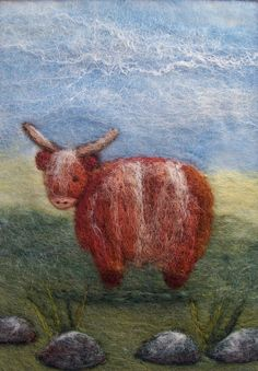 'Rhona Rhua' is a needle felted Highland Cow on a background of hand felted merino fibres and hand dyed fleece from the Orkney Island of North Ronaldsay. There are also some fibres from sheep bred on the Isle of Skye.  12x17cm