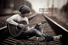 Railroad tracks and guitar