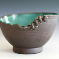 Samantha B. - I like this bowl because the uneven lip and coil laced through the holes creates an interesting and appealing design