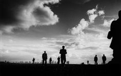 Trent Parke - Magnum Photos - AUSTRALIA. Sydney. Japanese tourists walk across a park in Dover Heights which looks out across the city of Sydney. From Dream/Life series. 1999.