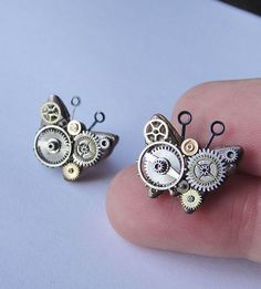 Elegance with an industrial flare: These lightweight earrings are a mixed metal collage combining watch and jewelry components on a polymer clay