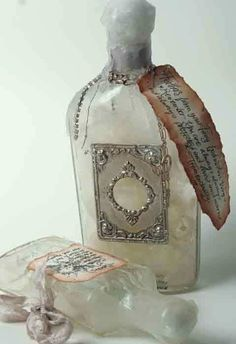 """Artifacts in antique medicine bottles from Victorian Trading Co. It reminds me of """"Alice In Wonderland."""""""