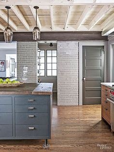 Love the colors and patterns! -A soaring ceiling, doorless pantry, and open layout keep the kitchen airy and ideal for entertaining. Doors Interior, Rustic Kitchen Design, Wood Doors Interior, Interior, Kitchen Design, Kitchen Remodel, Kitchen Renovation, Kitchen Ceiling, Home Decor