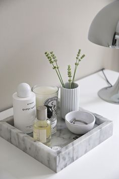 Lovely product in action shot that could appear in a lifestyle magazine. Utilising more natural, less harsh and direct lighting and featuring on a table with a lamp help create a sense of environment and contextualise the product.