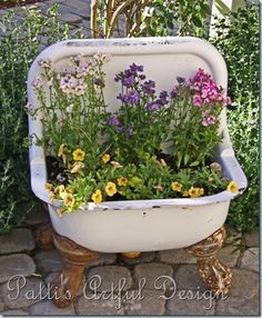 Old Porcelain Piece & Old Cast Iron Claw Feet...re-purposed into a sweet flower basin for the garden!!