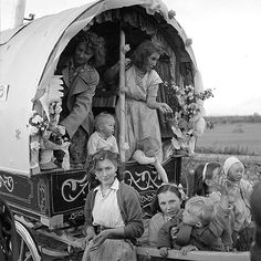 Irish Travellers in 1954. Family in their decorated caravan en route to the Cahirmee Horse Fair at Buttevant, Co. Cork