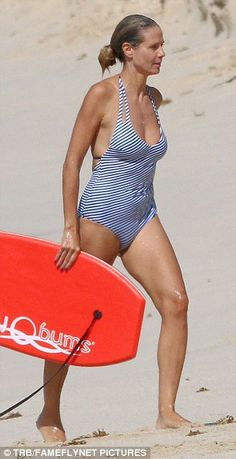 Heidi Klum shows off her slender figure as she splashes in the Caribbean with…