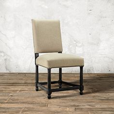 The Arhaus Vail Upholstered Dining Side Chair In Washed Linen & Black features a classic shape that makes an impression at any table.