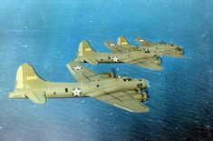 Three B-17E Flying Fortress bombers in flight, probably flying from Hendricks Filed, Florida, United States, 1941-1942