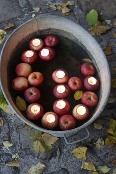 apples carved out and votives inside.  beautiful for a holiday table setting