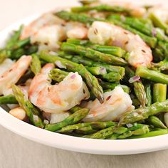 Asparagus and shrimp in a light vinaigrette makes a perfect dish for an elegant luncheon. Serve over a mix of greens or with an orzo or couscous salad. Photo credit: Amy Johnson from She Wears Many Hats.