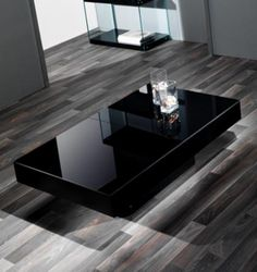 A coffee table is intended to be the focal point of a living room; without it, the interior looks insufficient as well as diminished. So selecting the right coffee table for the living-room is a cr… Black Painted Furniture, Wood Bedroom Furniture, Furniture Design, Coffee Table With Storage, Coffee Table Design, Central Table, Center Table Living Room, Couch Table, Modern Coffee Tables