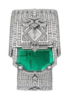 L'Heure Envoûtée de Cartier is a rich collection of rare stones  - an emerald magnifies this 'precious secret' watch whose tiny dial is concealed beneath the graphic lines of diamonds.