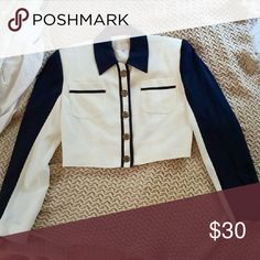 Classy Alberto Makali Crop Jacket Super classy cream colored cropped jacket with two pockets and regal looking buttons. The navy/mightnight blue gives it a nautical, sea-captain feel. I love this coat..bought it from another Posher..but i didn't know they had padded shoulders, and i found that doesn't look quite right on me. :( Says size 4, fits medium to large. Alberto Makali Jackets & Coats