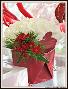 Asian tablescape with red flowers in a take out box