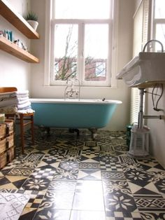 Blue bath, timber shelves, patterned floor tiles