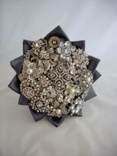 Brooch Bouquets....site has differt alternatives to real flowers for your bouquet