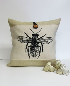 A personal favorite from my Etsy shop https://www.etsy.com/listing/125542152/bee-insect-screen-print-pillow-burlap