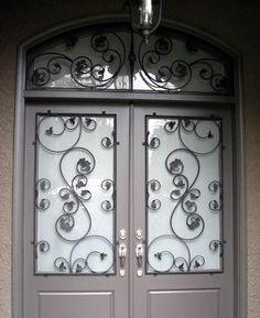 upgrade steel door with wrought iron inserts