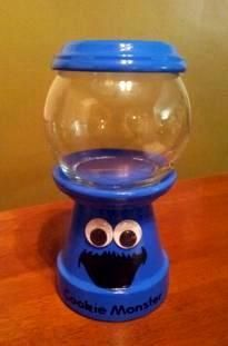 Customized/Personalized Childhood Character Inspired Gumball Machine Candy Jar.   Can be used for candy, nuts, change, beta fish, q-tips, cotton balls, hair pins or anything you can think of.  Visit Julie's Kraft Shack @ https://www.facebook.com/JuliesKraftShack