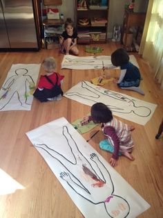 Little Village: Diligently painting body portraits.