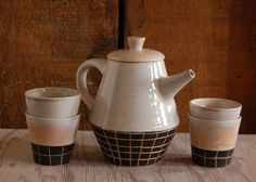 geometric black and white carved teapot with 4 matching teacups. $160.00, via Etsy.