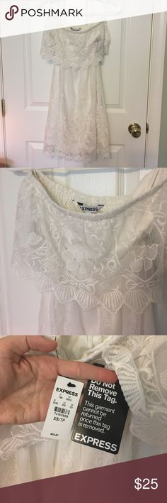 NWT Express Ivory Lace Strapless Dress NWT never worn! Just been hanging out in my closet.  Ivory Lace overly Strapless with cutout in the back. Beautiful design and slightly pointed scalloped edges. Could be worn with a cardigan for a more casual look! Express Dresses Strapless