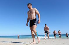 Leigh Halfpenny leads his team mates up the beach during the British and Irish Lions training session held at Langley Park on June 3, 2013 in Perth, Western Australia.