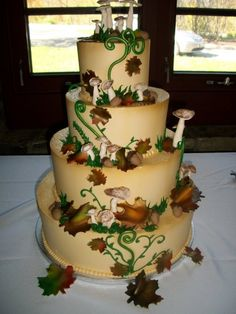 Design a cake based on the season of your wedding, like this forest inspired fall cake.