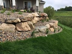 Terraced boulder retaining walls provide beauty, strength and longevity to your landscape. Boulder Retaining Wall, Backyard Retaining Walls, Building A Retaining Wall, Sloped Backyard, Sloped Garden, Retaining Wall Gardens, Retaining Wall Drainage, Retaining Wall Blocks, Landscaping With Boulders