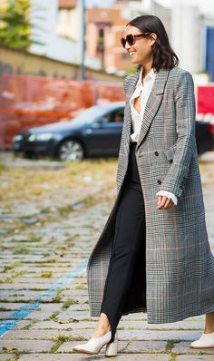 Pair a sleek plaid coat with stirrup pants and a button-town for a trendy work look.