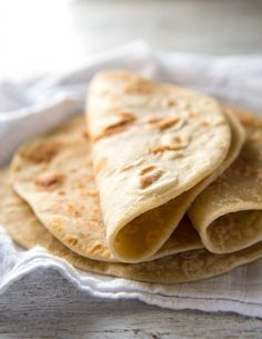 This super easy YEAST FREE flatbread is soft and pliable, perfect for using as a wrap to stuff with whatever takes your fancy! Minimal kneading, only a handful of ingredients, and also great for make ahead - the dough keeps for around 3 days in the refrigerator.