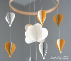 100% Merino Wool Felt Baby Mobile - Eco-Friendly - Rich, Lightfast Colors - Heirloom Quality - Yellow, White and Gray Hot Air Balloons by dundryhill on Etsy https://www.etsy.com/listing/182472830/100-merino-wool-felt-baby-mobile-eco