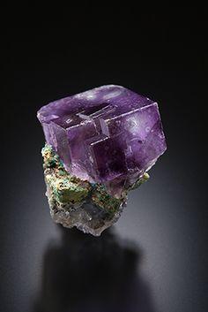 Cubic purple fluorite with phantom on a matrix. The crystal measures 1.7 x 1.6 x 1.2 cm.