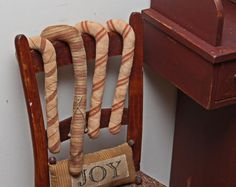 Prim Candy Canes...hung on an old red chair...Sweet joy...