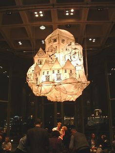 City scape lantern, inspired by Phillip Pullman's Northern Lights in the Olivier Theatre Foyer. Created by Di Jones