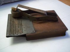 """Unusual Early Antique Wood Tin Nutmeg Grater M H Sexton Utica 1896... It dates from the 1800's and is an unusual grater. It measures about 3"""" wide by about 5-1/4"""" long and is in very good to excellent condition. It is marked """"M. H. SEXTON UTICA"""" and a patent date of 1896. The nutmeg is held in place and you move the metal piece back and forth to grate the spice."""