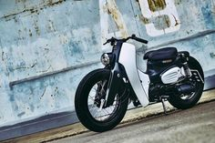 We saw the 2018 Honda Super Cub. TBH, we are hardly impressed, but this one here, a custom by K-Speed, is a whole new ball game. It made us wish the 2018 Honda Super Cub Honda Cub, Retro Bike, Retro Motorcycle, Motorcycle Shop, New Honda, Commuter Bike, Honda Logo, Custom Bikes, Custom Motorcycles